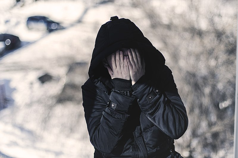 File:Depression - a lonely alcoholic in fear covers his face with his hands.jpg