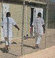 Detainees walk in an exercise yard in Camp 4.jpg
