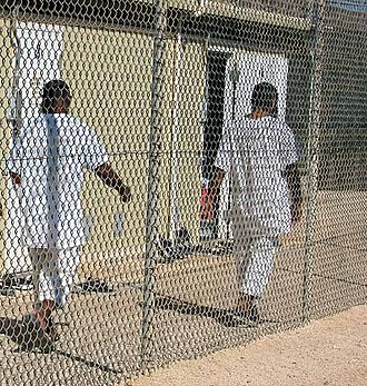 Guantanamo Bay detainee uniforms - Image: Detainees walk in an exercise yard in Camp 4