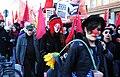 Domenstration gegen die Siko 2011 Clown in einer Gruppe von Autonomen.JPG
