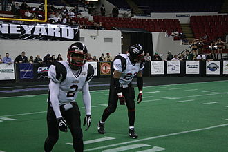 Continental Indoor Football League - Dontrell Jackson and J.R. Taylor of the Chicago Slaughter lining up for the snap against the Milwaukee Bonecrushers
