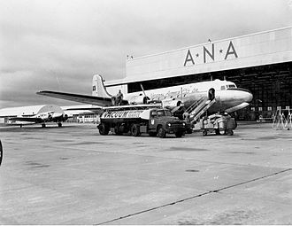 Australian National Airways - ANA Douglas DC-4 aircraft at Perth Airport in 1955.