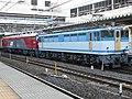 EF65 2127 in Ōmiya Station & EH500-53 in Ōmiya Station.jpg