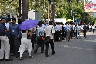 2012 Indian Ocean earthquakes - People evacuating high rise buildings on the streets in Kolkata, India, in front of the Cognizant building.