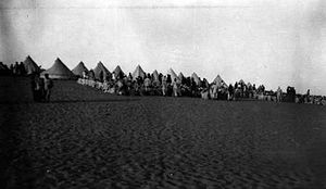 Egyptian Labour Corps - Egyptian Labour Corps engaged on road making, railway construction and laying water pipeline being paid at Romani in September 1916