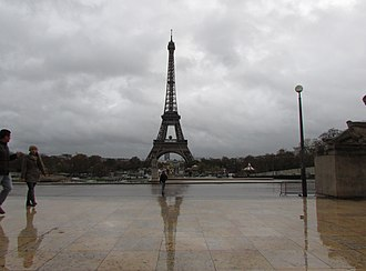 Specular reflection - Esplanade of the Trocadero in Paris after rain. The layer of water exhibits specular reflection, reflecting an image of the Eiffel Tower and other objects.