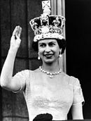 Elizabeth II waves from the palace balcony after the Coronation, 1953.jpg