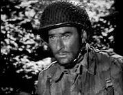 Errol Flynn as Capt. Nelson in Operation Burma!