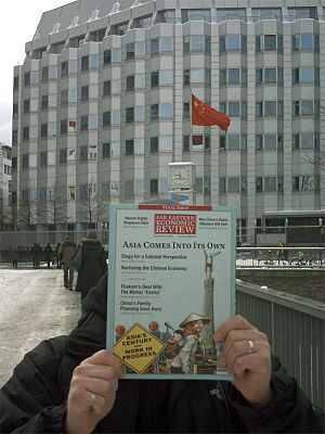 Far Eastern Economic Review - Former subscriber with the final issue of Far Eastern Economic Review (December 2009) in front of the Chinese Embassy in Berlin, Germany