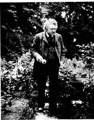"""Francis James Child - Child, a keen gardener and devotee of antique roses, photographed (probably by Charles Eliot Norton) in his rose garden. Verses about """"the rose and the briar"""" occur in many ballads."""