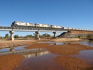 Fortescue railway - Three GE Dash 9-44CWs haul a train across the Turner River in July 2008