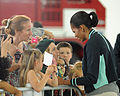 First lady of the United States Michelle Obama, right, greets U.S. military families at Royal Air Force (RAF) Mildenhall, England, July 29, 2012 120729-F-FV908-152.jpg