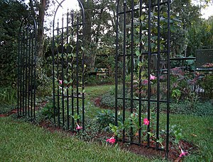 Trellis (architecture) - A series of trellises forms the wall of a garden room