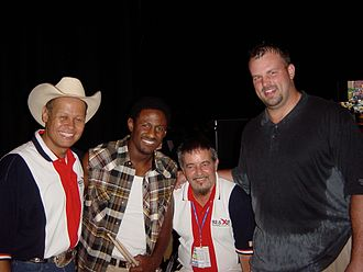 Freddie Mitchell - Mitchell (second from left) backstage at a country music concert in May 2003 with country singer Neal McCoy (far left) and Eagles teammate Jon Runyan (far right).