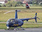 G-PIXX Robinson Raven 44 Helicopter Flying TV Ltd (29469323181).jpg