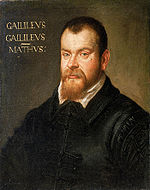 "A portrait of the head and upper body of a middle-aged man with a receding hairline and brown beard. He is wearing a black, Italian Renaissance outfit. The text ""GAILILEVS GAILILEVS – MATHVS:"" is painted to the left of the man's head."