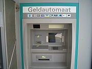 An ATM in the Netherlands. The logos of a number of interbank networks this ATM is connected to are shown.
