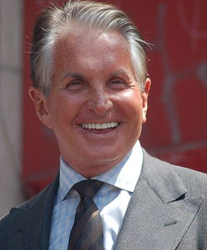 English: George Hamilton receiving a star on t...