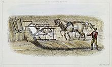 man guiding two horses pushing machine
