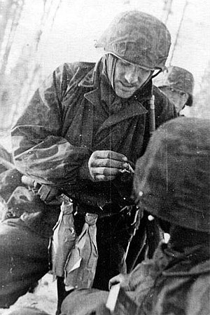Molotov cocktail - A German soldier with two Molotov cocktails on the Eastern Front