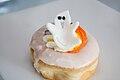 Ghost on a Halloween doughnut (15272956279).jpg