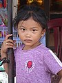 Girl on Sidewalk - Phnom Penh - Cambodia (48322181221).jpg