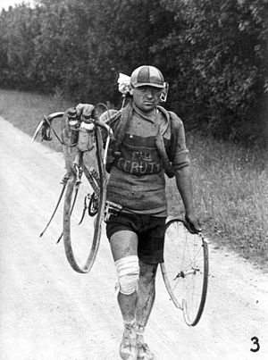 1928 Tour de France - Italian Giusto Cerutti has a broken wheel after a fall. According to the rules he is not allowed to accept help.