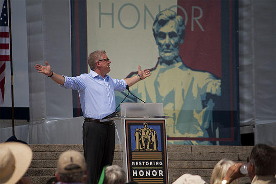 Beck during his religiously-themed speech at the Restoring Honor rally on August 28, 2010. Glenn Beck Restoring Honor Hands Out.jpg