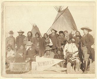 Grant Short Bull - Short Bull (top row, 4th from left) at meeting with US officials, Pine Ridge Reservation, 1891