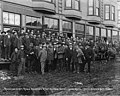 Group of men standing outside the Golden Gate Hotel, reception for Captain Roald Amundsen and Lieutenant Hansen, Nome, Alaska (AL+CA 2397).jpg
