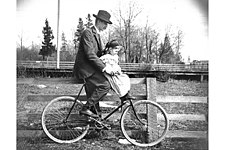 H. Ambrose Kiehl and his daughter, Laura Kiehl, on a bicycle, Washington (4951162891).jpg