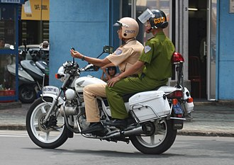 Crime in Vietnam - Police motorcycle in Ho Chi Minh City, Vietnam, photographed in June 2005