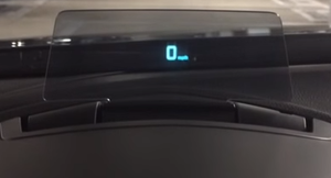 Automotive head-up display - HUD in a Mazda using a retractable combiner, rather than being reflected from the windshield.