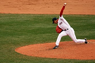 Hideki Okajima - Okajima's unorthodox delivery showing him looking down at the ground towards 3rd base as the ball is released.