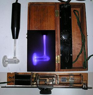 Violet ray - Antique violet ray set with glass electrode (left) and control box.  When energized, the glass electrode emitted a violet glow (inset, center)