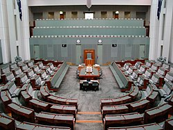 In the Australian House of Representatives, the Leader of the Opposition sits at the front table to the left of the Speaker's Chair (on the right-hand side in this photo).