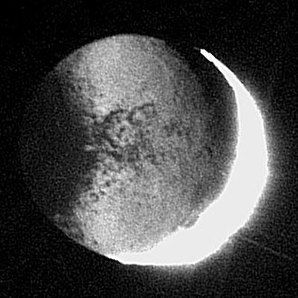 Planetshine - Saturn's moon Iapetus lit by Saturnshine. This is an enhanced picture; the planetshine is too dim by contrast to be visible to the unaided eye.