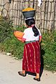 In Nebaj- woman with basket on head (6996020829).jpg