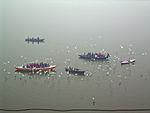 India - Varanasi - 019 - pilgrims feeding the birds (2146273483).jpg