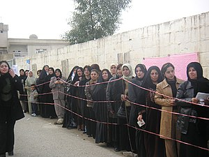 Segregated Iraqi women waiting to vote in elec...