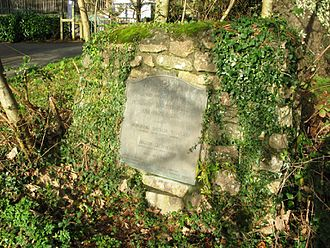 Ivybridge railway station - A plaque commemorating the opening, mounted on a granite boulder near the entrance