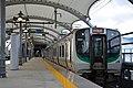 JRE E721 at Sendai Airport Station (30671099065).jpg