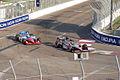 JR Hildebrand passes Graham Rahal into Turn 10 02 Morning Practice GPSP 27March2011 (14699601465).jpg