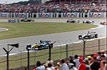 Jarno Trulli and Kimi Räikkönen 2003 Silverstone 2.jpg