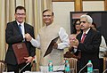 Jayant Sinha and the Federal Minister for Economic Cooperation & Development of Germany, Dr. Gerd Mueller exchanging the signed document between Govt. of India and Federal Republic of Germany, in New Delhi. The Secretary.jpg