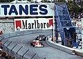 Jochen Mass - McLaren M23 leads Mario Andretti - Lotus 78 at Tabac at the 1977 Monaco GP.jpg