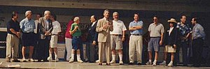 Joel Giambra - Joel Giambra (at Center in Beige Suit) Speaking at Italian Festival, Buffalo, NY, 2000