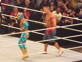 Carístico - Sin Cara teaming with John Cena at the WWE Raw tapings on April 18, 2011, in London, England