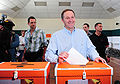 John Key placing vote in ballot box.jpg