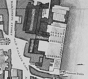 The Old Palace was a complex of buildings, separated from the River Thames in the east by a series of gardens. The largest and northernmost building is Westminster Hall, which lies parallel to the river. Several buildings adjoin it on the east side; south of those and perpendicular to the Hall is the mediaeval House of Commons. Further south and parallel to the river is the Court of Requests, with an eastwards extension at its south end, and at the south end of the complex lie the House of Lords and another chamber, the Palace was bounded by St Margaret's Street to the west and Old Palace Yard to the south-west; another street, New Palace Yard, is just visible to the north.